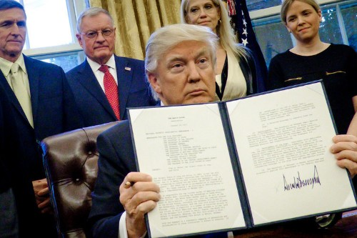What Trump's executive orders in his first 100 days were actually about