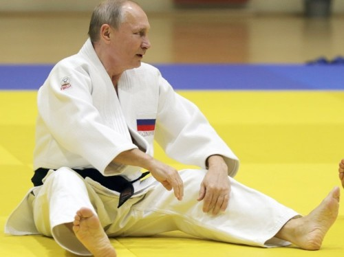 Vladimir Putin was pulled to the floor by a female judo star and cut his finger during a sparring session for the cameras
