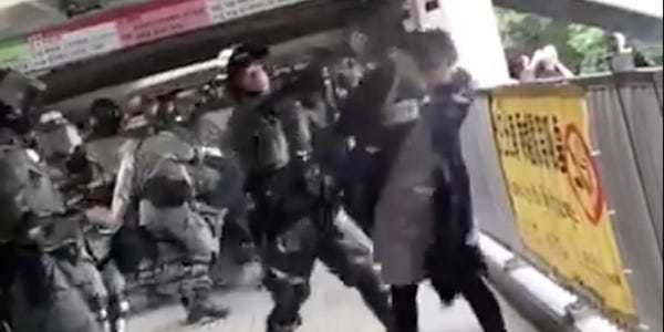 Video: Woman appears to be pepper sprayed, tackled by Hong Kong police - Business Insider