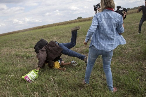 Here's a picture-by-picture look at the Hungarian camerawoman tripping a refugee and child
