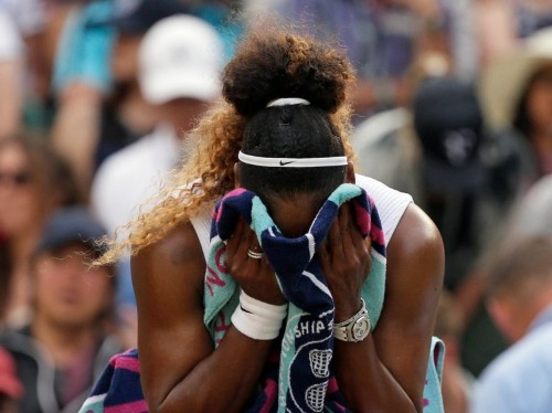 Serena Williams has been fined $10,000 for throwing her racket and damaging a court at Wimbledon