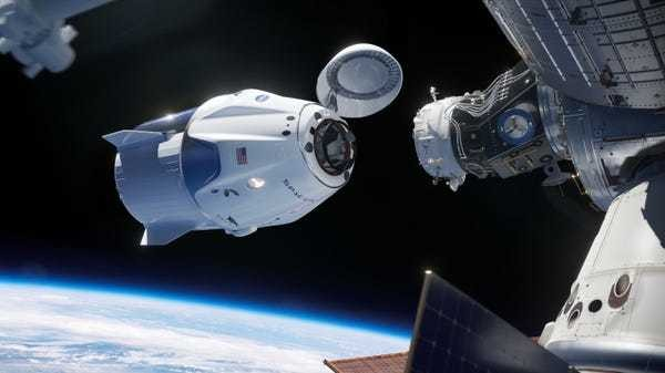 SpaceX docks Crew Dragon spaceship to the space station for first time - Business Insider