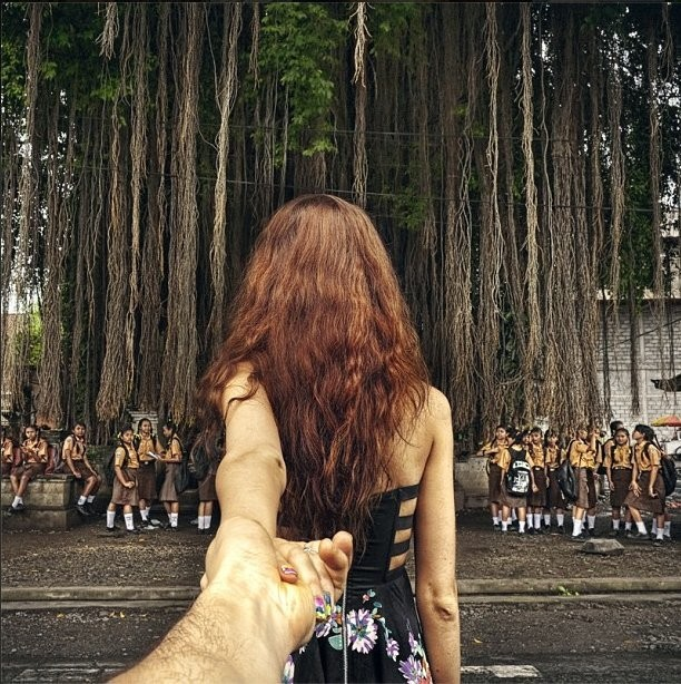 Photographer's Pictures Of His Girlfriend Leading Him Around The World Go Viral