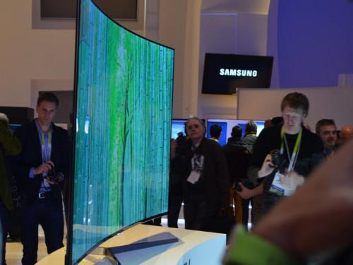 Samsung bragged that its new super-thin bezel-free TV is so beautiful that it doesn't even have 'unsightly' screws in the back