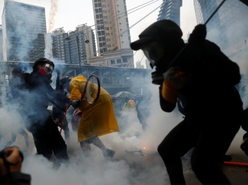Photos: Hong Kong protests turn violent, weapons and water cannons