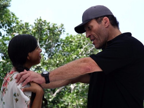 Tony Robbins has a two-step coaching process that gets results — and people pay him thousands of dollars for it