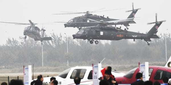 China shows off Z-20 Black Hawk lookalike helicopter and flying saucer - Business Insider