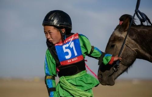 Mongolian child jockeys mount up at Naadam festival