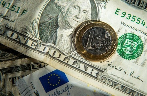 Euro sinks close to 12-year low versus dollar
