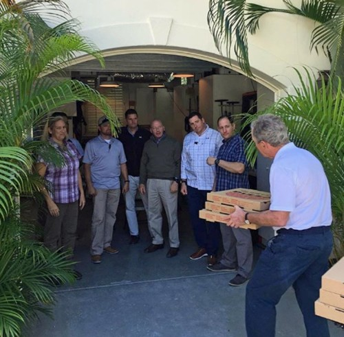 Former President George W. Bush delivers pizza to his Secret Service detail as they work without pay during the government shutdown