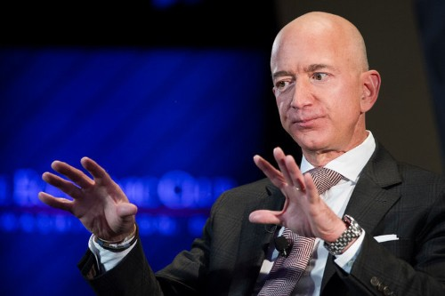 Tech moguls like Jeff Bezos and Mark Zuckerberg would lose billions under Elizabeth Warren's tax plan