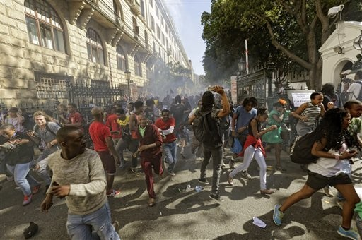 South African police are firing rubber bullets and tear gas at students