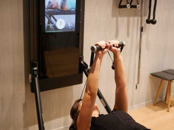 I tried an at-home machine that's like a Peloton for strength training - Business Insider