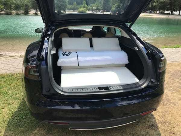 DreamCase converts Teslas into camping tents using the trunk as a bed - Business Insider