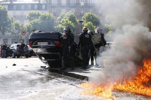 French anti-Uber protests turn violent as cabbies burn cars