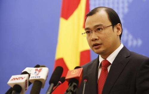 Vietnam accuses China of violating its sovereignty by landing a plane on contested part of the South China Sea