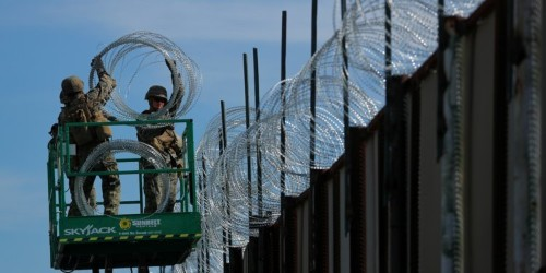 Mexicans in the world's most violent city are taking barbed wire right off the border wall and to protect their own homes