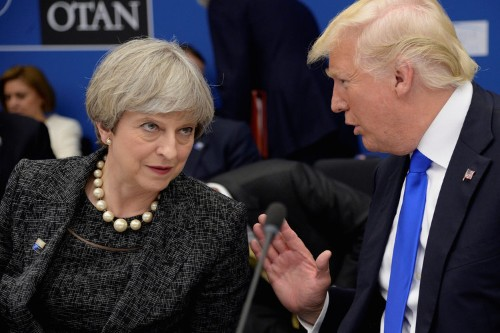Theresa May wants Trump 'to find a way to come back' to Paris deal
