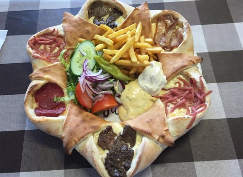 Swedes are going crazy for this 'pizza volcano' topped with 4 different meats and fries