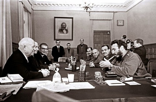 Fidel Castro, wearing 2 Rolexes, lighting a cigar while visiting the USSR for the first time
