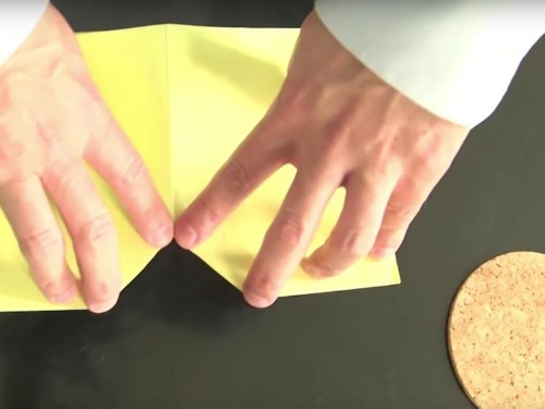 A captivating illusion of a round disk fitting through a tiny square hole is the coolest bar trick you need to know
