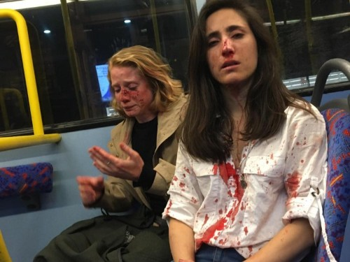 2 gay women say they were beaten by men on a London bus because they refused to kiss for their entertainment
