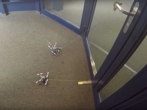 These tiny wasp-inspired drones can open a door 40 times their weight, and could one day be used in disaster zones