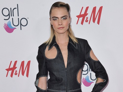 Cara Delevingne wore a daring denim jumpsuit covered with holes - Business Insider