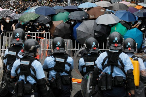 Stunning video shows Hong Kong protesters part like a wave to allow an ambulance to pass