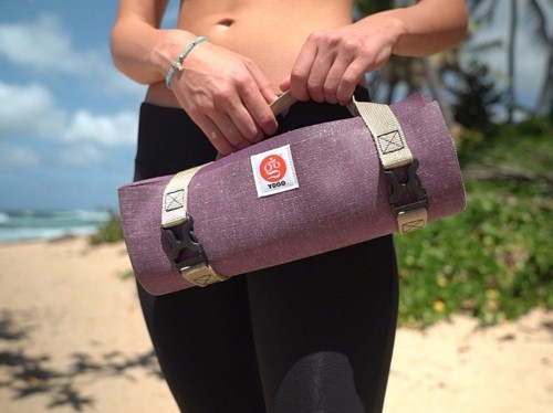 This travel yoga mat weighs much less than a regular one and folds up to the size of a newspaper