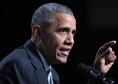 Strident Obama says gun control laws will change