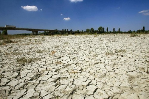 Climate talks told to ease rifts as heat busts record
