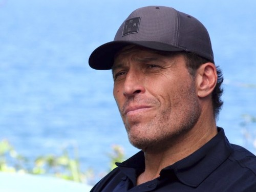 Tony Robbins started out as a broke janitor — then he saved a week's worth of pay, and the way he spent it changed his life