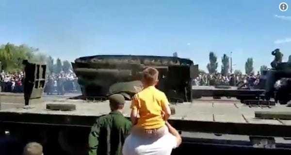 Russian T-34 tank embarrassingly barrel rolls off trailer in parade - Business Insider