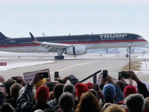 Donald Trump's plane does dramatic flyby as 'Air Force One' theme song plays at campaign rally