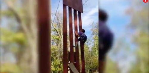 An 8-year-old girl climbed an 18-foot replica of Donald Trump's 'un-climbable' border wall in seconds