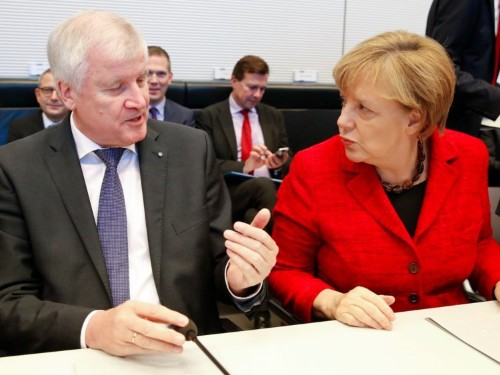 'Paris changes everything': Angela Merkel's allies are pressuring her to reverse Germany's 'open-door' refugee policy