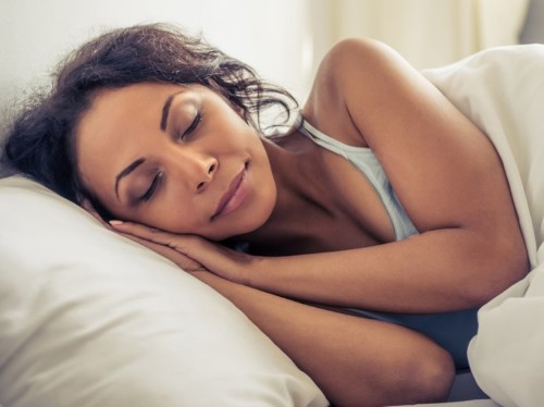 Here's why you should always sleep on your side, according to sleep experts