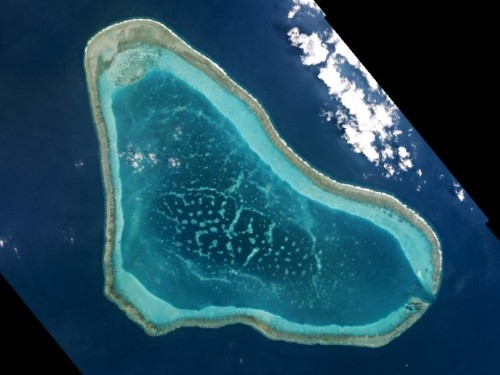 China plans to build its 1st structure on disputed land in South China Sea near US military assets