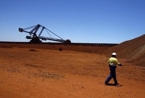 BHP's boss faces $11 billion dilemma as prices languish