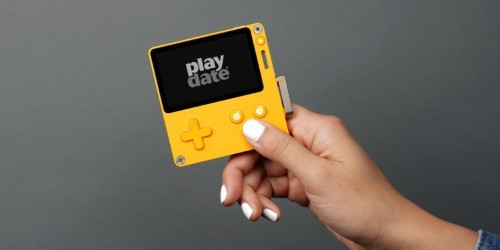 Playdate black-and-white game console with hand crank generates buzz