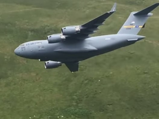 "Watch a US C-17 Globemaster make a low-level pass through the ""Mach Loop"" for the first time"