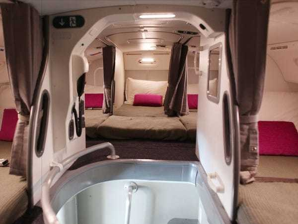 See the secret airplane bedrooms where flight attendants sleep on long-haul flights - Business Insider