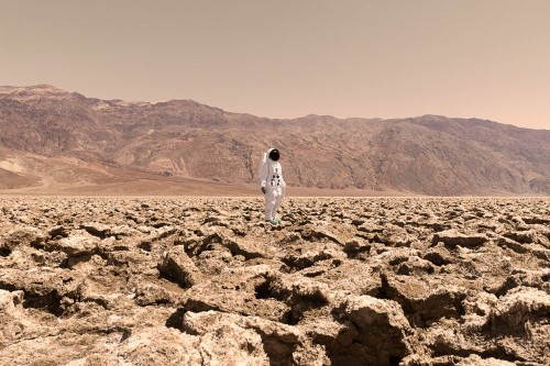 A photographer took these utterly surreal photos of himself in places that look like Mars to make a statement about humanity