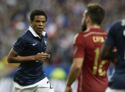Remy strike condemns Spain to friendly defeat