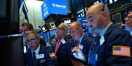 Stocks climb, oil slides as investors look ahead to Fed rate decision