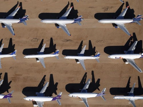 Boeing beats on earnings, misses on revenue, and reaffirms its outlook for 2015