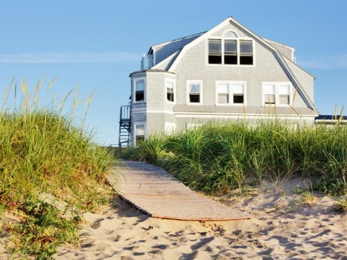 Rich millennials are buying vacation homes before starter homes. There are 3 things you should consider before buying one, says a financial expert.