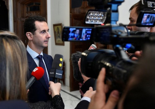 Assad says the Syrian government is ready to negotiate on 'everything' — including his own position