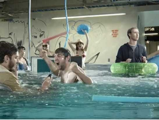 Facebook Employees Really Did Stand Fully Dressed In A Pool For Its New Ad